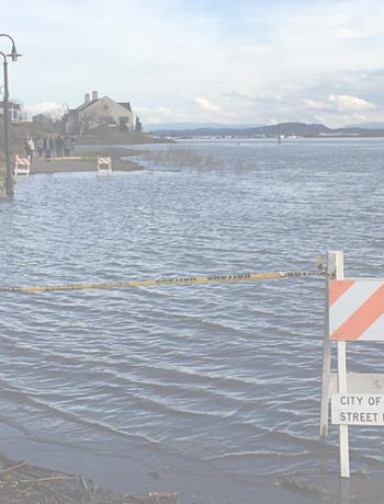 image of the Columbia River flooding along the waterfront